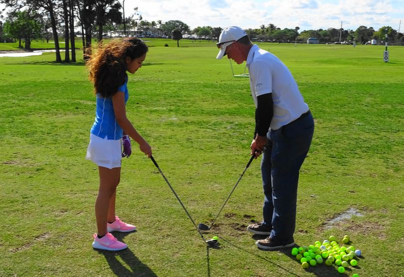 Glen Beaver helps students prepare for their high school golf team.